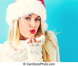 Happy young woman blowing a kiss - Happy young woman with...