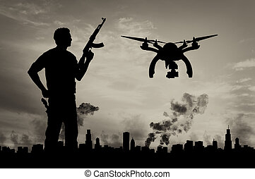 Silhouette flying reconnaissance drone over city in a smoke...