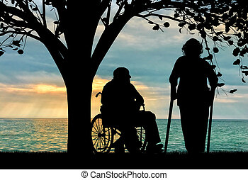 Silhouette of two people with disabilities. Disabled person...
