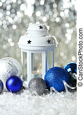 Candlestick with christmas ball on lights background
