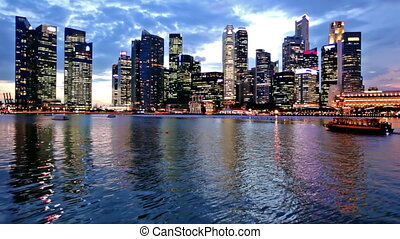 Singapore city skyline at evening with reflection