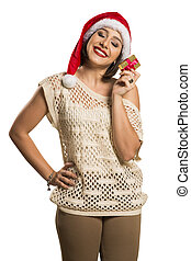 Christmas gift. Smiling beautiful woman in red hat and scarf...