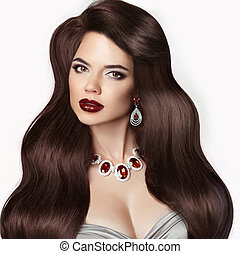 Retro Brunette woman with long shiny wavy hair Beauty makeup...