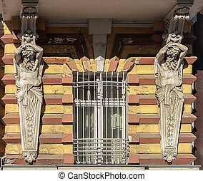 Window with lattice and caryatids - Window of old building...
