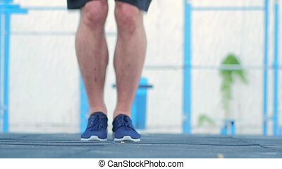 Jumps on a skipping rope. Slow motion - Jumps on a skipping...
