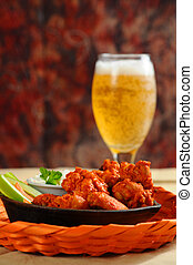 Buffalo Wings - Buffalo style chicken wings served with cold...