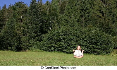 little girl meditating in nature