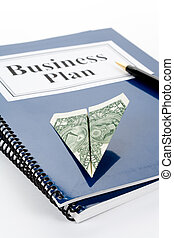 Business Plan and dollar with white background