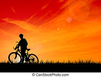 Silhouette of the biker on a sunset background