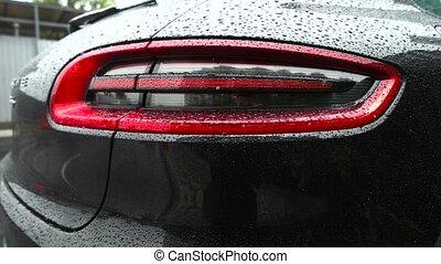 Car headlight flashing in the rain