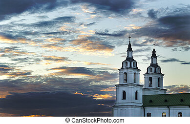 church against the evening sky - the two towers of the...