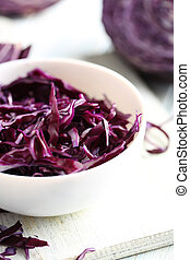 Ripe red cabbage on a blue wooden table