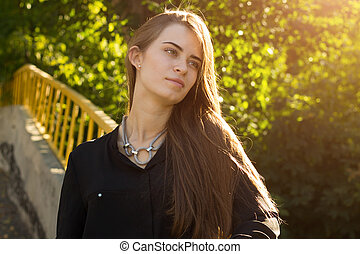 Young woman on the background of trees and sunlight - Young...