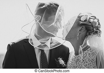 black and white photo the bride  groom on the background of field
