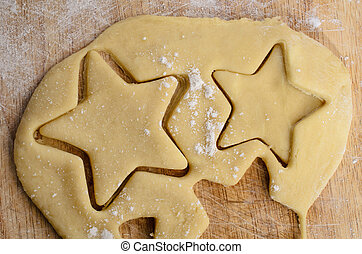 Rolled Biscuit Dough with Star Shapes Cut Out - Rolled...