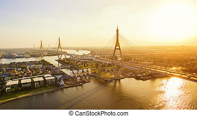 sun light and bhumiphol bridge crossing chaopraya river in...