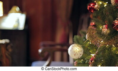 A dolly shot shot of a decorated Christmas - Christmas tree...