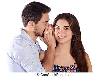 Man whispering secret to his girlfriend. - Portrait of a...