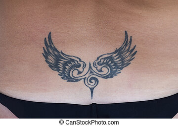 The tattoo in the shape of wings on the back. Simple tattoo...