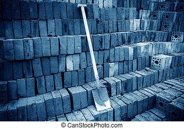 Brick building site - Construction site shovel and brick,...