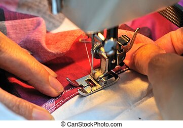 Hand guiding sewing needle - Hand at sewing machine with...