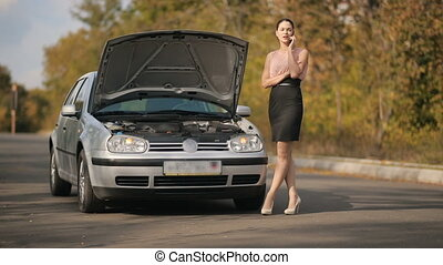 Woman calling by the phone near broken car - Road trip car...