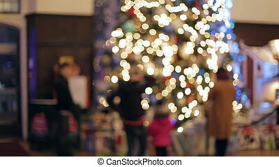 Blurred Christmas background with crowd