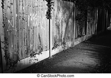 Back Alley with Graffiti on Fence - Quite back alley with...