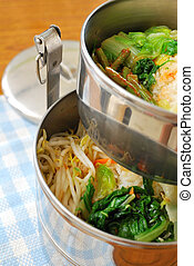 Takeout meals in metal containers. For concepts such as diet...