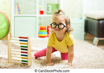 funny baby weared glasses with counter toy - funny baby with...
