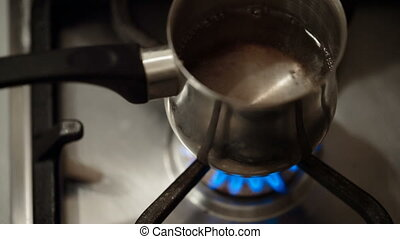 ladle of water heated - small ladle of water heated on gas