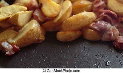 potato fried bacon and eggs - potato slices fried bacon and...