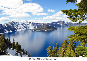 Snowy Summer at Crater Lake - View of Crater Lake during the...