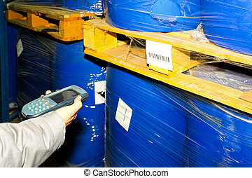 Barcode scanner - Worker hold barcode scanner in the hand
