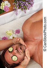 Man getting a massage - A Caucasian man lies on a massage...