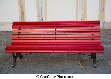 lonely red park bench