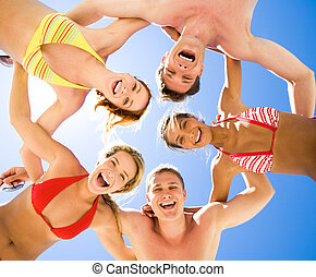 Cheerful friends - Below view of laughing teens in swimwear...