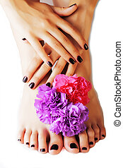 manicure pedicure with flower close up isolated on white...