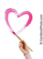 Shape of heart - Photo of human hand holding brush and...
