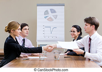 Consensus - Photo of businesspartners shaking hands after...
