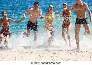 Dynamism - Photo of happy friends splashing water while...