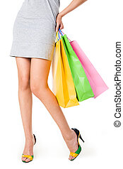 Legs of shopper - Close-up of beautiful female legs and...