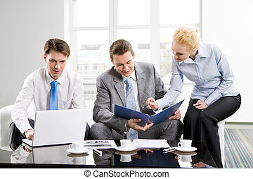 Office work - Photo of three employees planning their work...