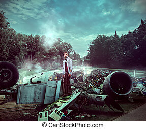 Man after wreckage standing on the plane ruins