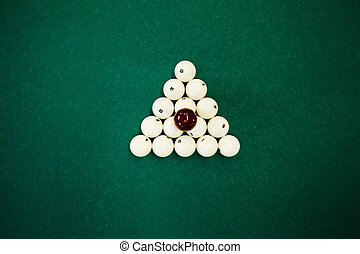 Cue balls - Top view of cue balls on the green table