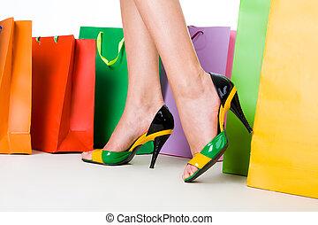 Luxury - Close-up of female legs wearing stylish shoes...