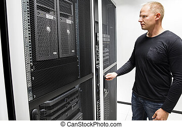 Technician Opening Server Rack Door In Data Center