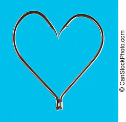 Blue heart - Photo of heart shape madeup of two hooks put...
