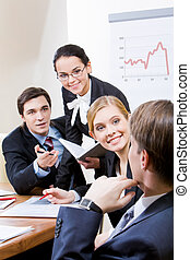 Conversation - Photo of business group having hot discussion...