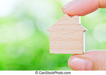 my house - hand holding icon house, concept image of make...